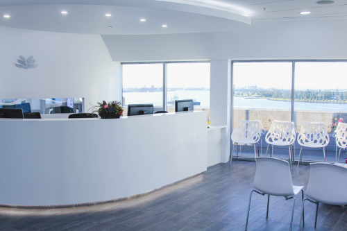 Lotus Dermatology recption counter with view of Newcastle Harbour