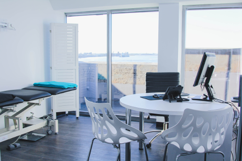 Lotus Dermatology specialist consultation room with view of Newcastle Harbour